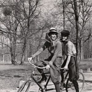 Joanna Shimkus and Phyllis Major ride a bike.
