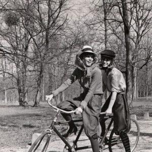 Joanna Shimkus and Phyllis Major ride a bike.