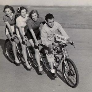 Rosemary, Lola and Priscilla Lane ride a taxi bike.