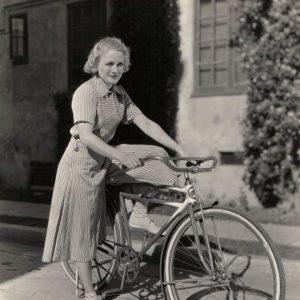 Wynne Gibson rides a bike.