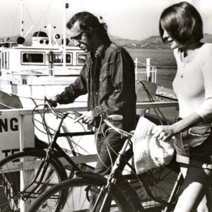 Woody Allen and Diane Keaton walk bikes.
