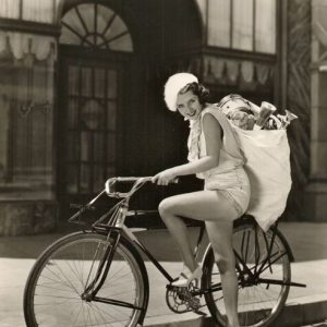 Susan Fleming hoists a sack of gifts, ready to ride. Happy Holidays from Rides a Bike!