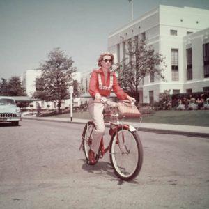 Grace Kelly rides a bike.