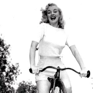Marilyn Monroe rides a bike. Highly.
