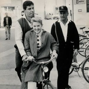 Jerry Lewis and Connie Stevens ride a bike.