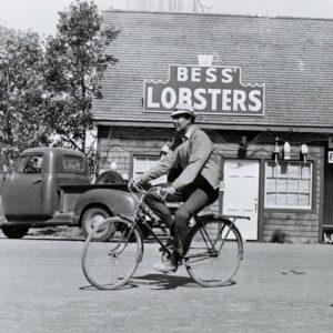 Carl Reiner rides a bike.