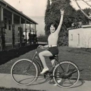"Margaret Livingston rides a bike, waves hello. On the lot in 1924, three years before ""Sunrise."""