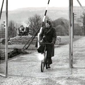 Richard Gere rides a bike.
