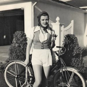 Margaret Sullavan wields a racket, eats an apple, gets ready to ride..