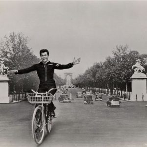 "Tony""Look Ma No Hands"" Curtis rides a bike."