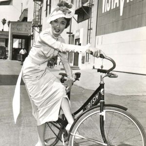 Ann Blyth attempts to ride a bike.