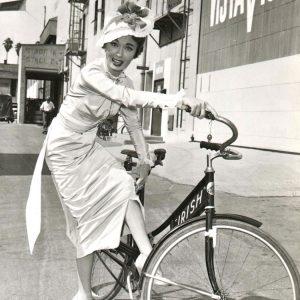 Ann Blyth attempts to ride a bike.