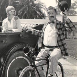 Billy Bevan rides a bike.