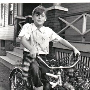 Kieran Culkin rides a bike.