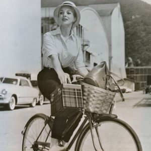 Venetia Stevenson rides a bike.