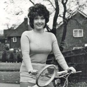 Deborah Watling rides a bike