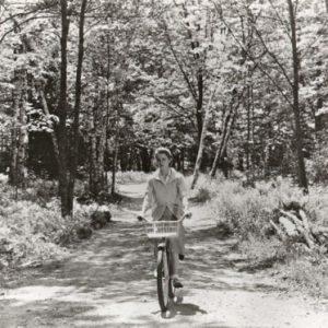 Diane Varsi rides a bike