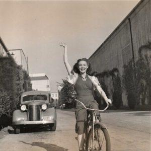 Joan Leslie rides a bike