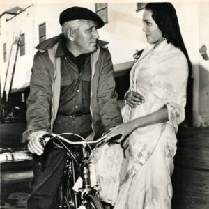Spencer Tracy rides a bike