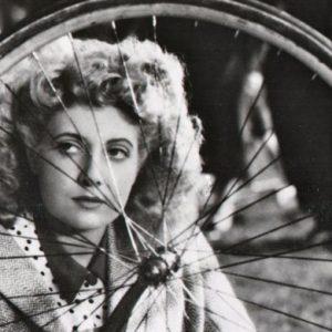 Micheline Presle considers a bike.
