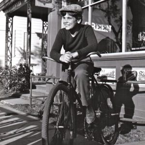Dean Stockwell rides a bike.