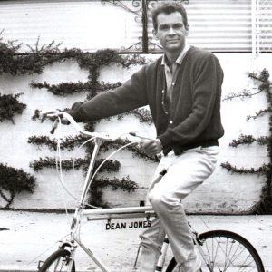 Dean Jones rides a bike.