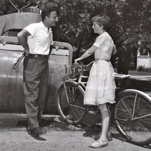 Julie Harris walks a bike — into Fred Zinneman and a steamroller.