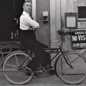 William Powell rides a bike.