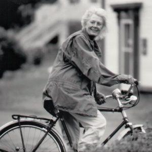 Vanessa Redgrave rides a bike.