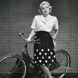 Lana Turner models a bike.