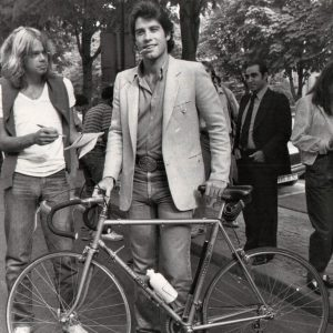 John Travolta wrangles a bike.