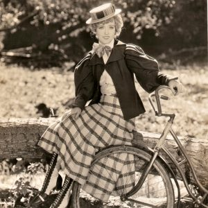 Marion Davies rides a fence.