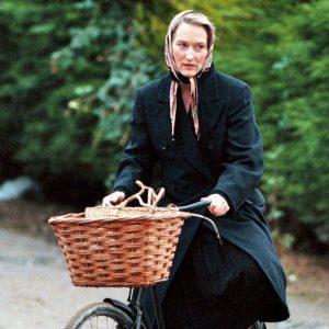 Meryl Streep rides a bike.