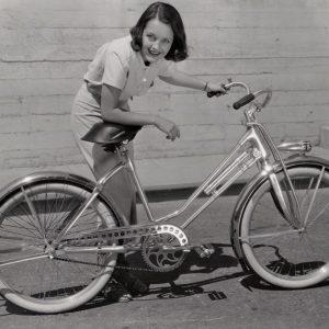 Rochelle Hudson leans on a bike.