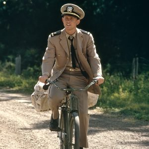 Ron Howard rides a bike.