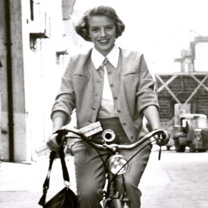 Rosemary Clooney rides a bike.