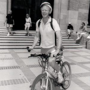 Ed Begley Jr rides a bike.