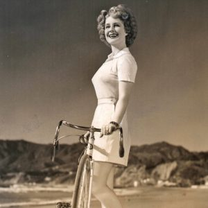 Norma Shearer coasts a bike.