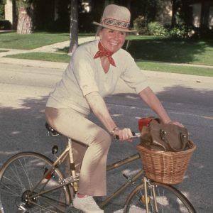 Doris Day rides a bike.