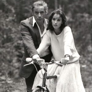 Isabelle Adjani rides a bike, Yves Montand does something.