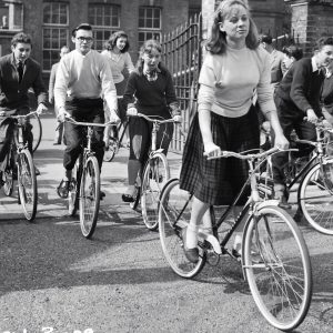 Carol White, Jacqueline Lewis and George Howell ride bikes.