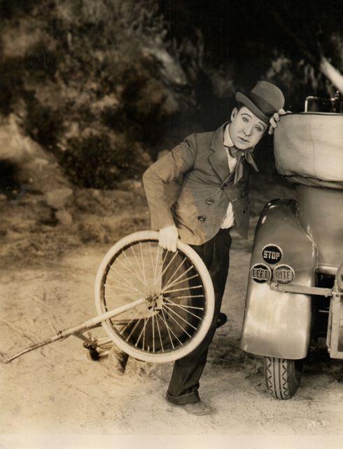 Harry Langdon picks up a bike