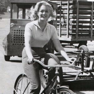 Jan Sterling rides a bike.