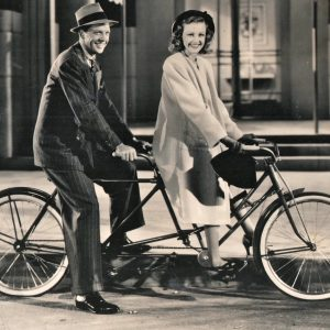 Dan Dailey and Virginia Grey ride a bike.