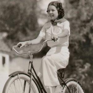 Frances Langford rides a bike.