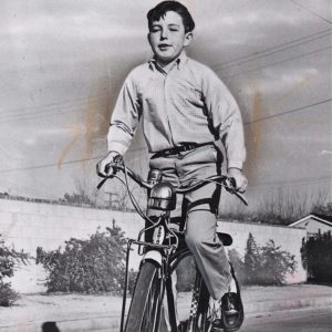 Jerry Mathers rides a bike.