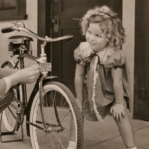 Shirley Temple gets ready to ride.