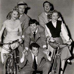 Marie Wilson, John Lund, Diana Lynn and Don DeFore ride bikes. Lewis rides Martin.