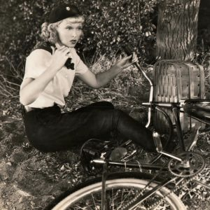 Joyce Compton falls from a bike.