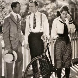 Mae Clark cries over her bike, Otto Kruger and Lee Tracy discuss.